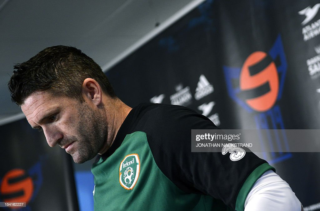 Ireland's national football team captain Robbie Keane arrives a press conference on October 15, 2012, one day before the FIFA 2014 World Cup group C qualifying football match Faroe Islands vs Ireland at the Torsvollur stadium in Torshavn.