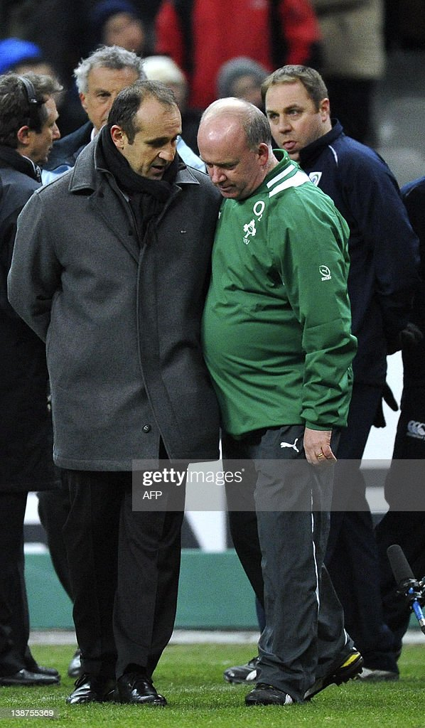 Ireland's national rugby team's head Declan Kidney (R) and France's national rugby team's head coach Philippe Saint-Andre talk near the deputy referee prior to the Six Nations rugby union match France versus Ireland at the Stade de France in Saint-Denis, outside Paris, on February 11, 2012. The match was cancelled due to the cold.