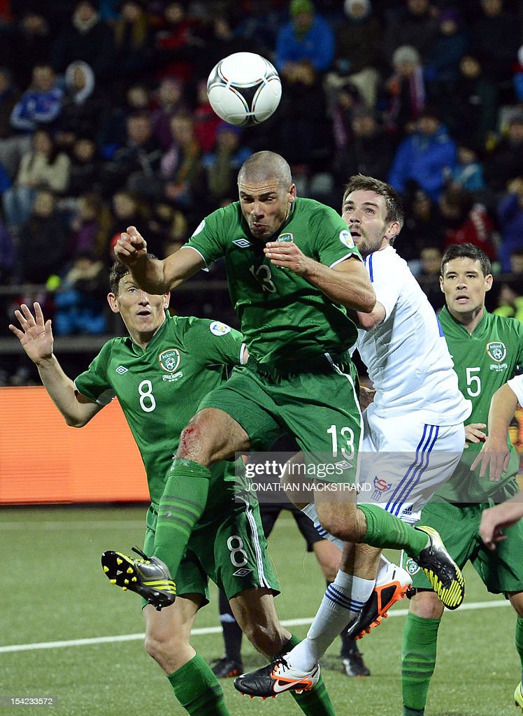 Ireland's national team football player Jon Walters (13) goes for a header during the FIFA 2014 World Cup group C qualifying football match Faroe Islands vs Ireland at the Torsvollur stadium in Torshavn on October 16, 2012. AFP PHOTO / JONATHAN NACKSTRAND