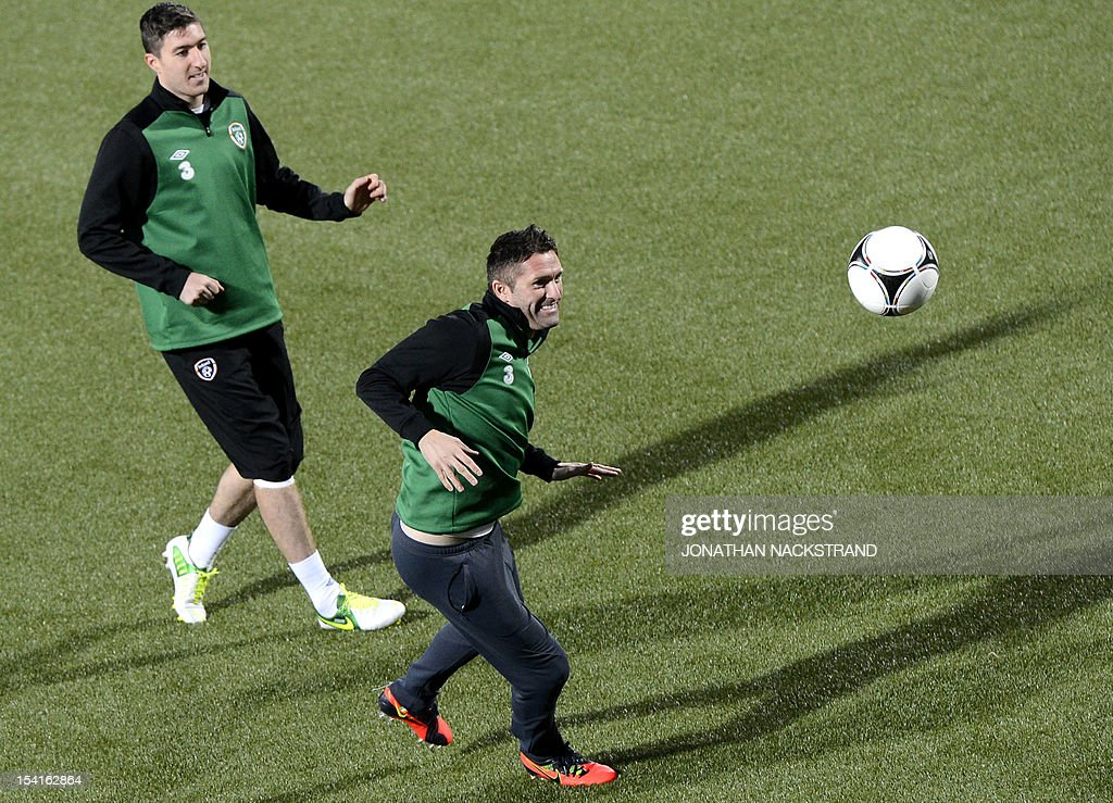 Ireland's national team football players captain Robbie Keane (R) and Sean St Ledger take part in a training session on October 15, 2012, one day before the FIFA 2014 World Cup group C qualifying football match Faroe Islands vs Ireland at the Torsvollur stadium in Torshavn.