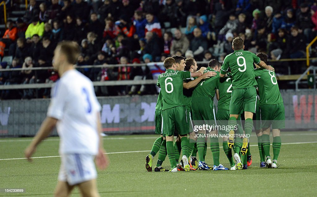 Ireland's national team football players celebrate after Jonathan Walters (hidden) scored during the FIFA 2014 World Cup group C qualifying football match Faroe Islands vs Republic of Ireland at the Torsvollur stadium in Torshavn on October 16, 2012.