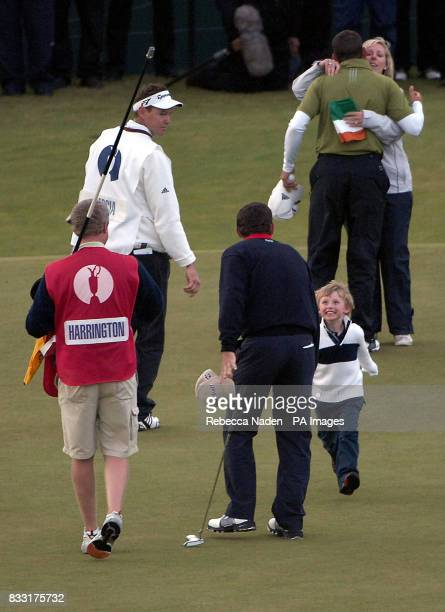 Ireland's Padraig Harrington's son Patrick Runs to greet him as his wife Caroline consoles Sergio Garcia after the Final day of The 136th Open...