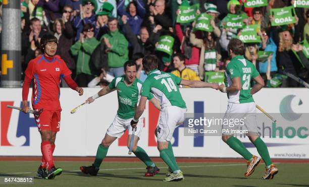 Ireland's Peter Caruth celebrates his goal during their International Hockey Federation Olympic qualifing match at Belfield in Dublin