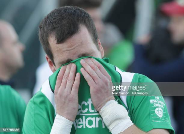 Ireland's Peter Caruth reacts after they were beaten during their International Hockey Federation Olympic qualifing match at Belfield in Dublin