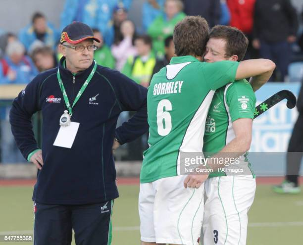 Ireland's Peter Jackson Ronan Gormley and John Jackson react after they were beaten during their International Hockey Federation Olympic qualifing...
