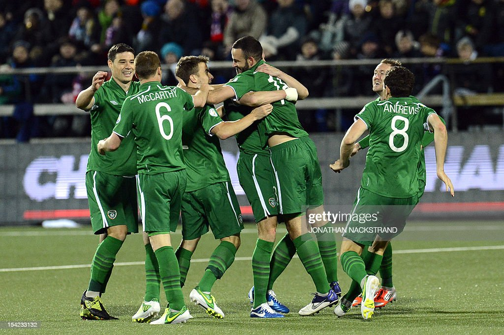 Ireland's players celebrate after their striker Jonathan Walters (3rd R) scored during the FIFA 2014 World Cup group C qualifying football match Faroe Islands vs Ireland at the Torsvollur stadium in Torshavn on October 16, 2012.