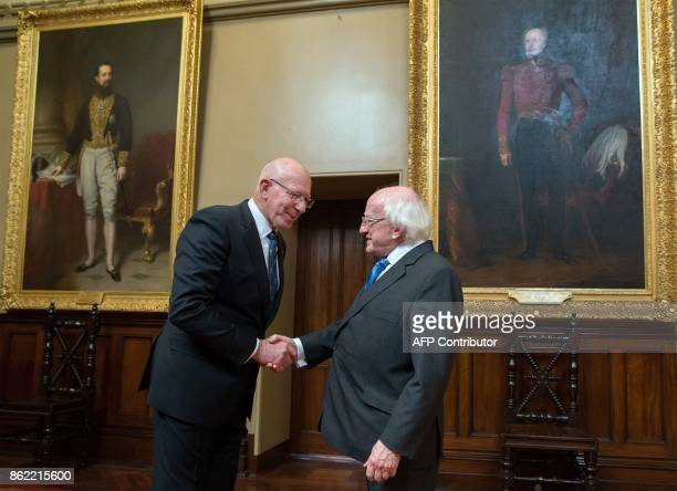 Ireland's President Michael Higgins shakes hand with New South Wales' Governor David Hurley at Government House in Sydney on October 17 2017 Higgins...