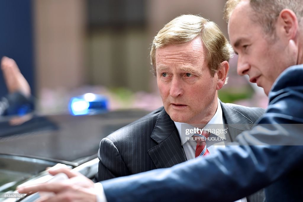 Ireland's Prime minister Enda Kenny arrives before an EU summit meeting on June 28, 2016 at the European Union headquarters in Brussels. / AFP / PHILIPPE