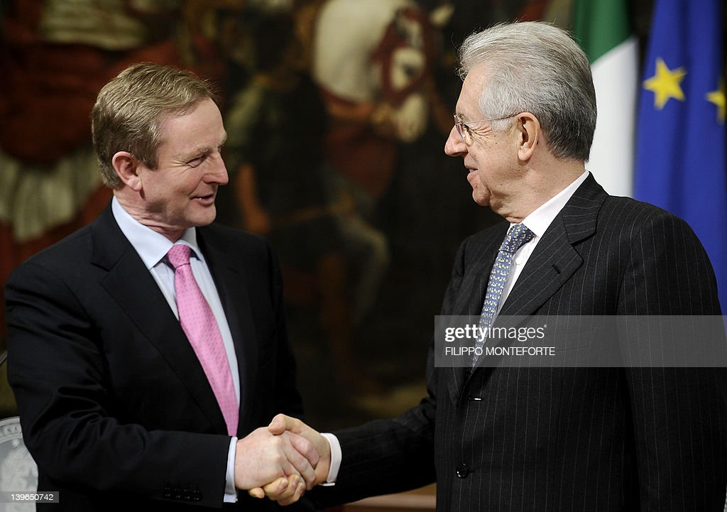 Ireland's Prime Minister Enda Kenny (L) shakes hands with his Italian counterpart Mario Monti during a meeting at Palazzo Chigi in Rome on February 23, 2012.