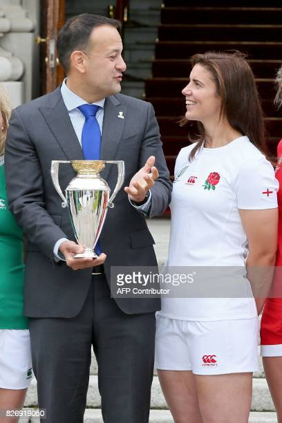 Ireland's Prime Minister Leo Varadkar holds the trophy as he chats with England's captain Sarah Hunter in front of the government buildings in Dublin...