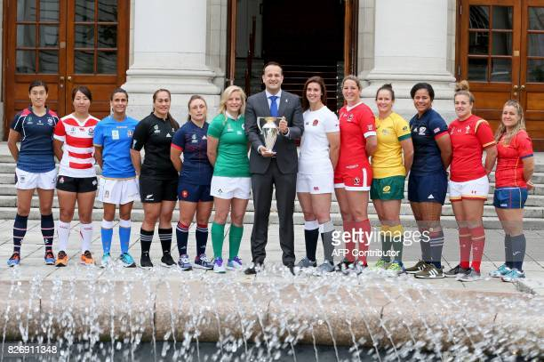 Ireland's Prime Minister Leo Varadkar poses with the trophy flanked by Hong Kong's captain Chow Mei Nan Japan's captain Seina Saito Italy's captain...