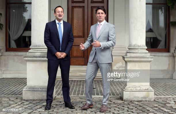 Ireland's Prime Minister Leo Varadkar shares a joke with Canada's Prime Minister Justin Trudeau on his arrival at Farmleigh House in Dublin on July 4...