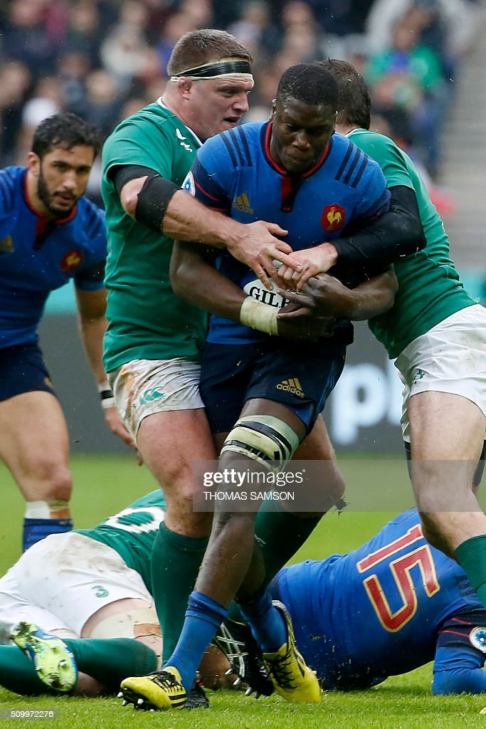 Ireland's prop Nathan White (L) tackles France's flanker Yacouba Camara during the Six Nations international rugby union match between France and Ireland at the Stade de France Stadium in Saint-Denis, north of Paris, on February 13, 2016. AFP PHOTO / THOMAS SAMSON / AFP / THOMAS SAMSON
