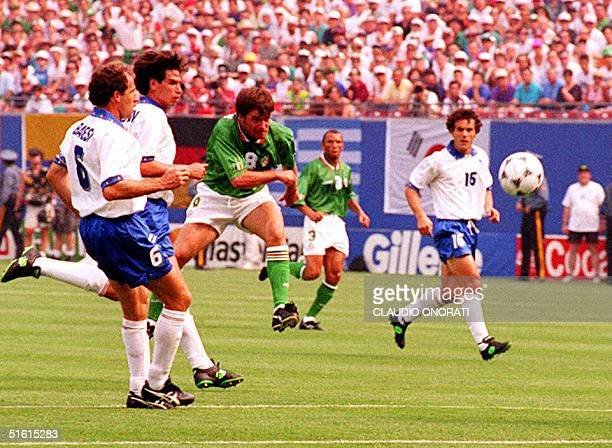 Ireland's Ray Houghton watches his shot go in the goal 18 June 1994 during the first half of the game against Italy Houghton scored and gave Ireland...