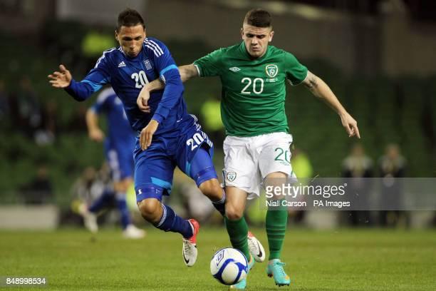 Ireland's Robbie Brady and Greece's Jose Holebas battle for the ball during the International Friendly at the Aviva Stadium Dublin Ireland