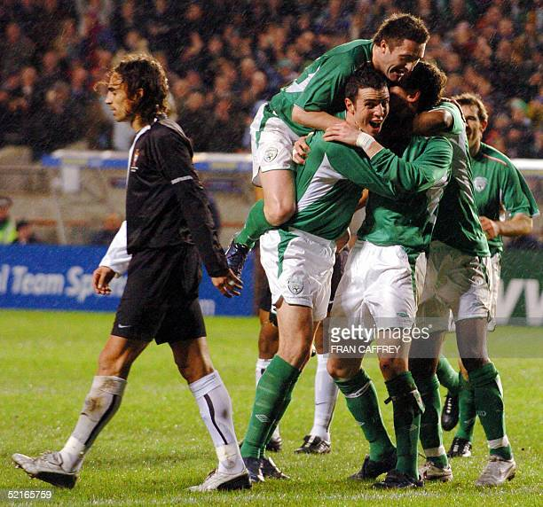 Ireland's Robbie Keane tops off Ireland's celebrations after Andy O'Brien scored the winning goal as Portugal's goal keeper Ricardo during their...