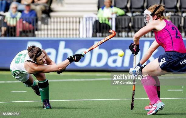TOPSHOT Ireland's Roisin Upton vies for the ball with Scotland's Alison Howie during the women's Hockey Rabo EuroHockey Championships 2017 match...