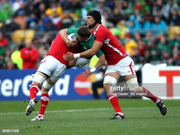 Ireland's Ronan O'Gara is tacked by Wales' Luke Charteris and Sam Warburton