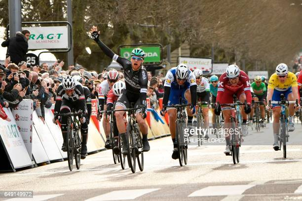 Ireland's Sam Bennett celebrates as he crosses the finish line ahead of Norway's Alexander Kristoff Germany's Marcel Kittel and France's Arnaud...