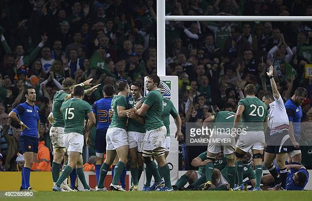 Ireland's scrum half Conor Murray is congratulated by teammates after scoring their second try during the Pool D match of the 2015 Rugby World Cup...
