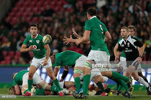 Ireland's scrumhalf Conor Murray clears the ball during the second Rugby Test match between South Africa and Ireland at Ellis Park on June 18 2016 in...
