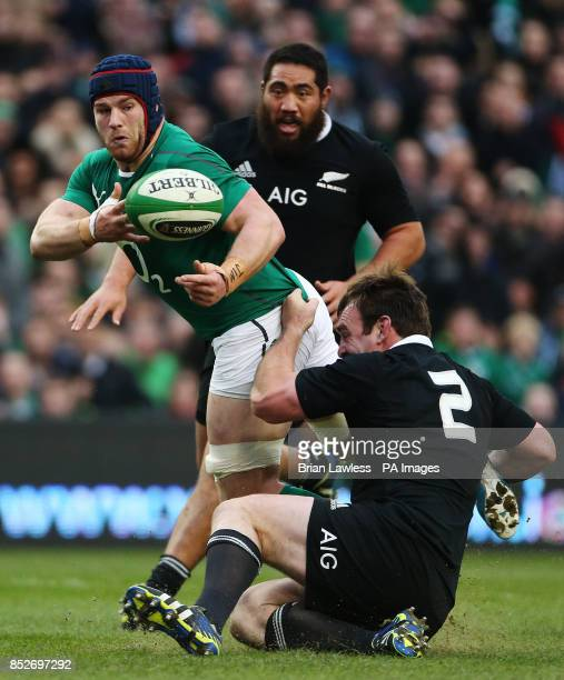Ireland's Sean O'Brien and New Zealand's Andrew Hore during the Guinness Series match at the Aviva Stadium Dublin Ireland