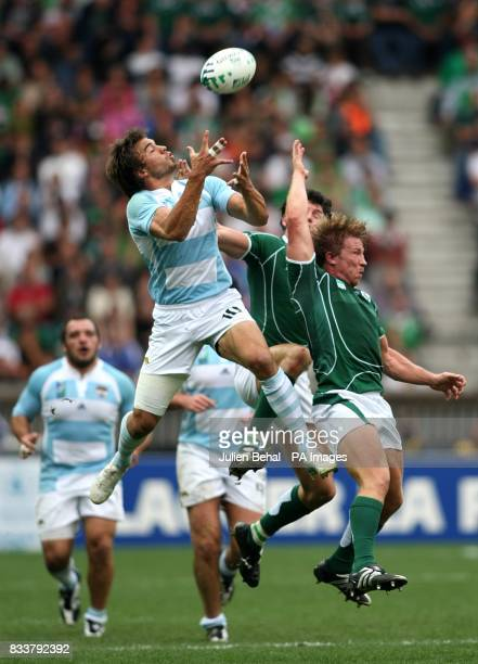 Ireland's Shane Horgan Jerry Flannery and Argentina's Juan Hernandez jump for the ball