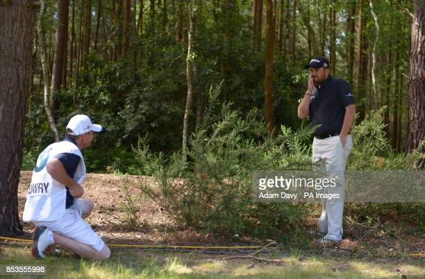 Ireland's Shane Lowry stuck in the heavy rough during day four of the BMW PGA Championships at the Wentworth Club Surrey