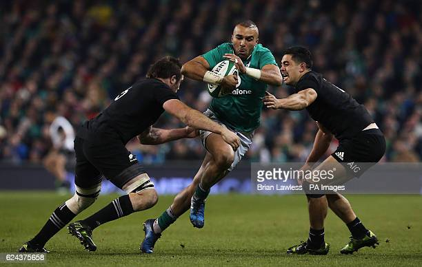 Ireland's Simon Zebo and New Zealand's Anton LienertBrown and New Zealand's Liam Squire during the Autumn International match at the Aviva Stadium...