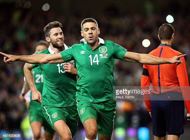 Ireland's striker Jonathan Walters celebrates after scoring his team's first goal from a penalty during a UEFA Euro 2016 Group D qualifying second...