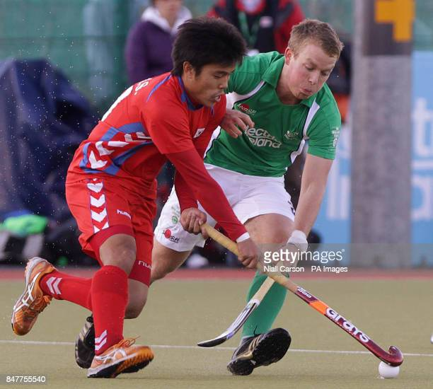 Ireland's Stuart Loughery and South Korea's Hyo Sik You during their International Hockey Federation Olympic qualifing match at Belfield in Dublin