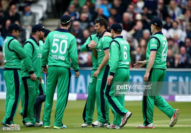 Ireland's Tim Murtagh celebrates with team mates after bowling out Alex Hales of England during the Royal London ODI between England and Ireland at...