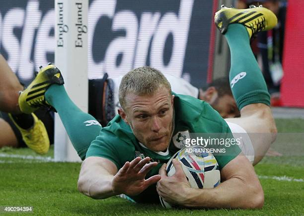 Ireland's wing Keith Earls scores their second try during a Pool D match of the 2015 Rugby World Cup between Ireland and Romania at Wembley stadium...