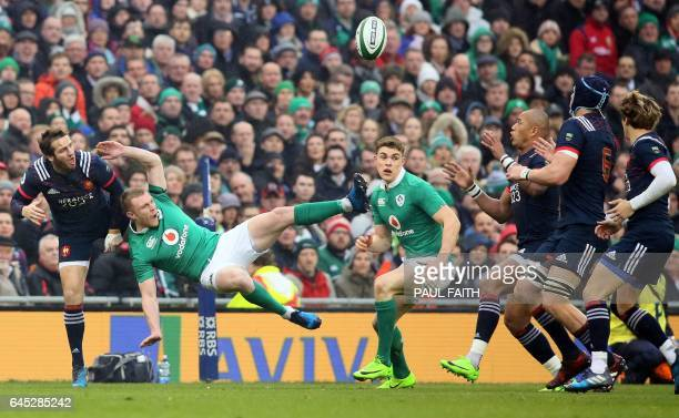 Ireland's wing Keith Earls vies with France's flyhalf Camille Lopez during the Six Nations international rugby union match between Ireland and France...