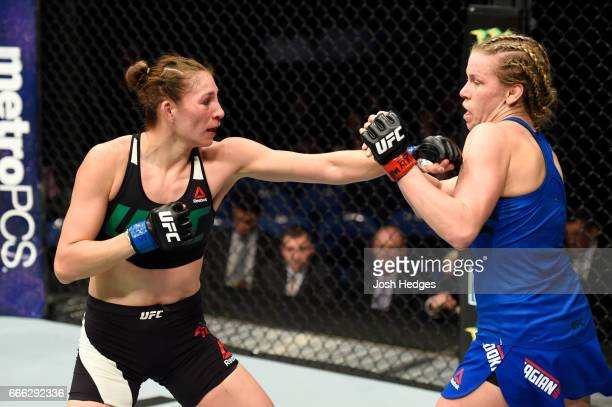 Irene Aldana of Mexico lands a punch on Katlyn Chookagian in their women's bantamweight bout during the UFC 210 event at KeyBank Center on April 8...