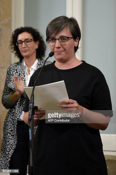 Irene Boya of the Catalan proindependence anticapitalist party 'Candidatura d'Unitat Popular CUP' holds a document about the independence of...