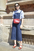 Irene Buffa poses wearing Asos overall Franz Lauer bag and Dolce and Gabbana shoes on June 21 2015 in Milan Italy