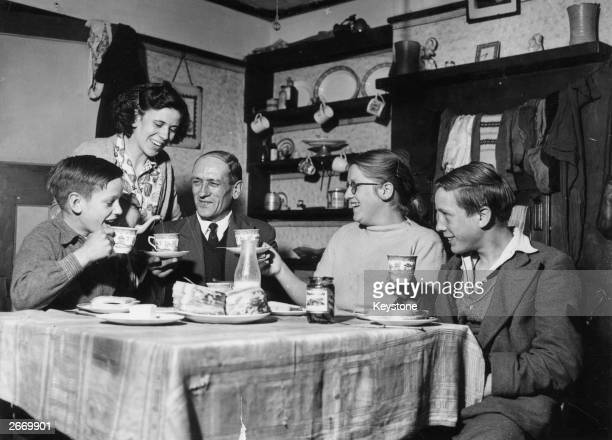 Irene Christmas pours tea for her fiance Nelson West at his home at Alton surrounded by his children Martin Brenda and Tony