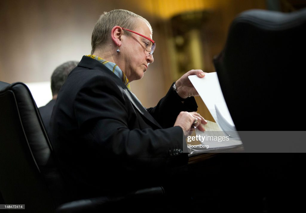 Irene Dorner, president and chief executive officer of HSBC North America Holdings Inc., looks through documents during a hearing of the U.S. Senate Homeland Security and Governmental Affairs Committee's Permanent Subcommittee on Investigations in Washington, D.C., U.S., on Tuesday, July 17, 2012. HSBC Holdings Plc's head of group compliance, David Bagley, told the Senate panel he will step down amid charges the bank gave terrorists, drug cartels and criminals access to the U.S. financial system by failing to guard against money laundering. Photographer: Joshua Roberts/Bloomberg via Getty Images