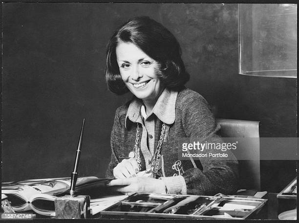 Irene Galitzine Russian princess and fashion designer naturalized Italian smiles sitting at her desk Italy 1970