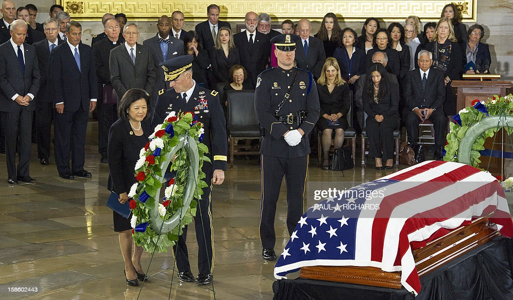 Irene Hirano Inouye stands by a wreath as her husband, US Senator Daniel K. Inouye,(D-HI), Lies in State with a flag draped casked on the floor of the US Capitol Rotunda December 20, 2012, in Washington, DC. Inouye, one of the last World War II heroes in Congress and the longest-serving member of the US Senate, having represented Hawaii since the state joined the union in 1959, died at age 88. AFP PHOTO/Paul J. Richards