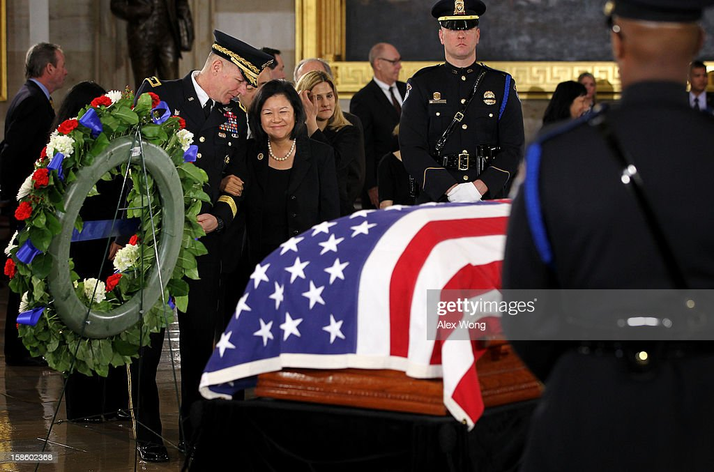 Irene Hirano Inouye, wife of the late Senator Daniel Inouye (D-HI), takes a last look at the flag draped casket at the Rotunda of the U.S. Capitol during a service December 20, 2012 on Capitol Hill in Washington, DC. The late Senator had died at the age of 88 on Monday at the Walter Reed National Military Medical Center in Bethesda, Maryland where he had been hospitalized since early December. A public funeral service will be held at the Washington National Cathedral on Friday for Senator Inouye, a World War II veteran and the second-longest serving senator in history. His remains will be returned and laid to rest in his home state.