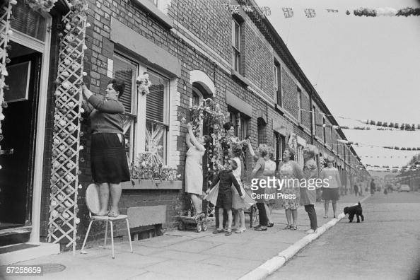 Irene Hughes and other residents of Claudia Street add the finishing touches to their decorations in preparation for the match between Bulgaria and...