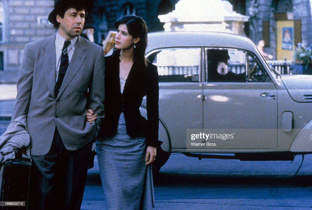 Irene Jacob walking arm and arm with Stephen Rea in a scene from the film 'All Men Are Mortal' 1995