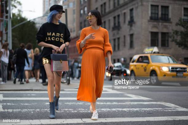 Irene Kim Eva Chen are seen attending Marc Jacobs during New York Fashion Week wearing Marc Jacobs Ksenia Schnaider adidas Originals on September 13...