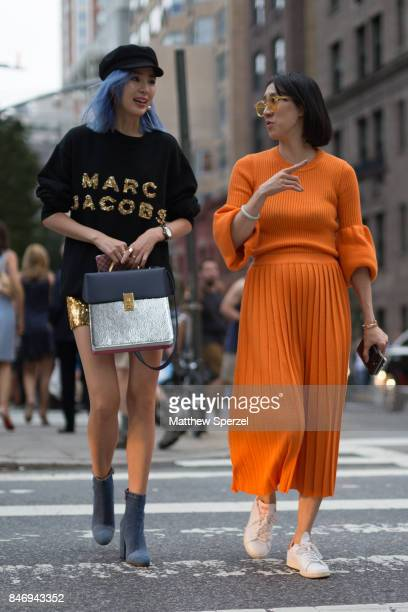 Irene Kim Eva Chen are seen attending Marc Jacobs during New York Fashion Week wearing Marc Jacobs Ksenia Schnaider adidas Originals on September 13...