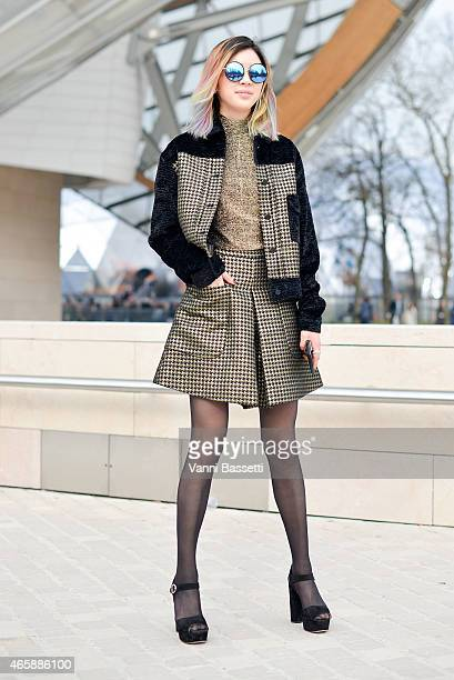 Irene Kim poses after the Louis Vuitton show on Day 9 of Paris Fashion Week Womenswear FW15 on March 11 2015 in Paris France