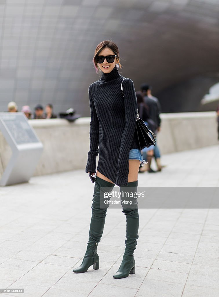 celine gray 7rv7  Irene Kim wearing a black navy grey sweater from Celine with long sleeves,  green overknees