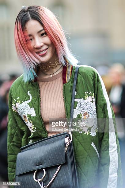 Irene Kim wears a Chloe bag after the Chloe show during Paris Fashion Week Womenswear Fall Winter 2016/2017 on March 3 2016 in Paris France
