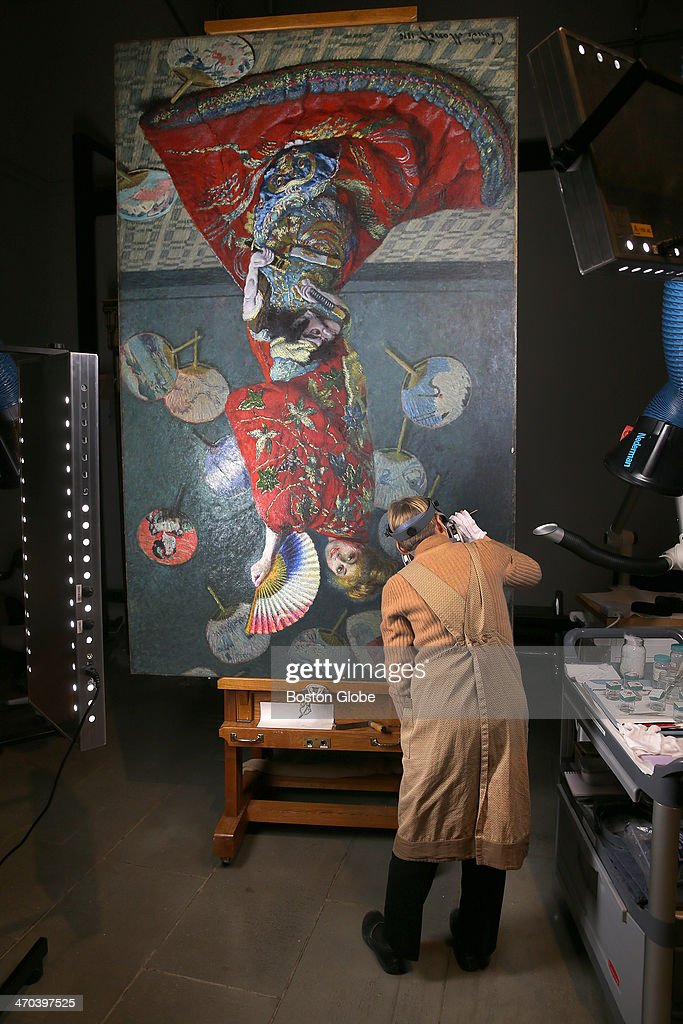 Irene Konefal worked on a restoration of the Claude Monet painting 'La Japonaise' at the Museum of Fine Arts on Tuesday, wearing a mask for protection against vapors.